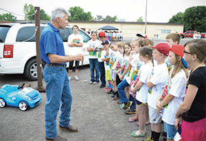 OEC worker teaching students at the Live line program from OEC in Oklahoma.