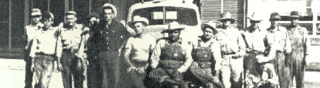 Historical photo with a close up view of OEC workers